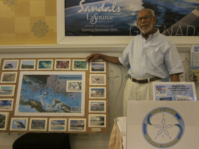 Mr. Minns displays the Moriah Harbour Cay Land and Sea Park map.