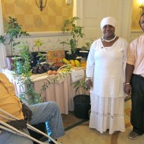 The Hall Family of Rolle Town shows off fruits and vegetables from their farm.