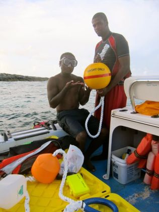 Dwayne Deveaux and Howard Bethel with a buoy at Fowl Cay.